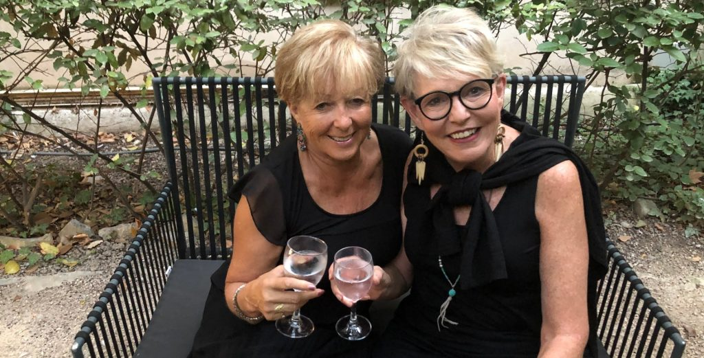 Deborah Bine and Patricia Sands drinking a glass of wine in the south of Franceb