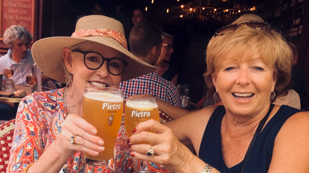 Deborah Bine and Patricia Sands enjoying a beer at a bar in the south of france on the memories tour