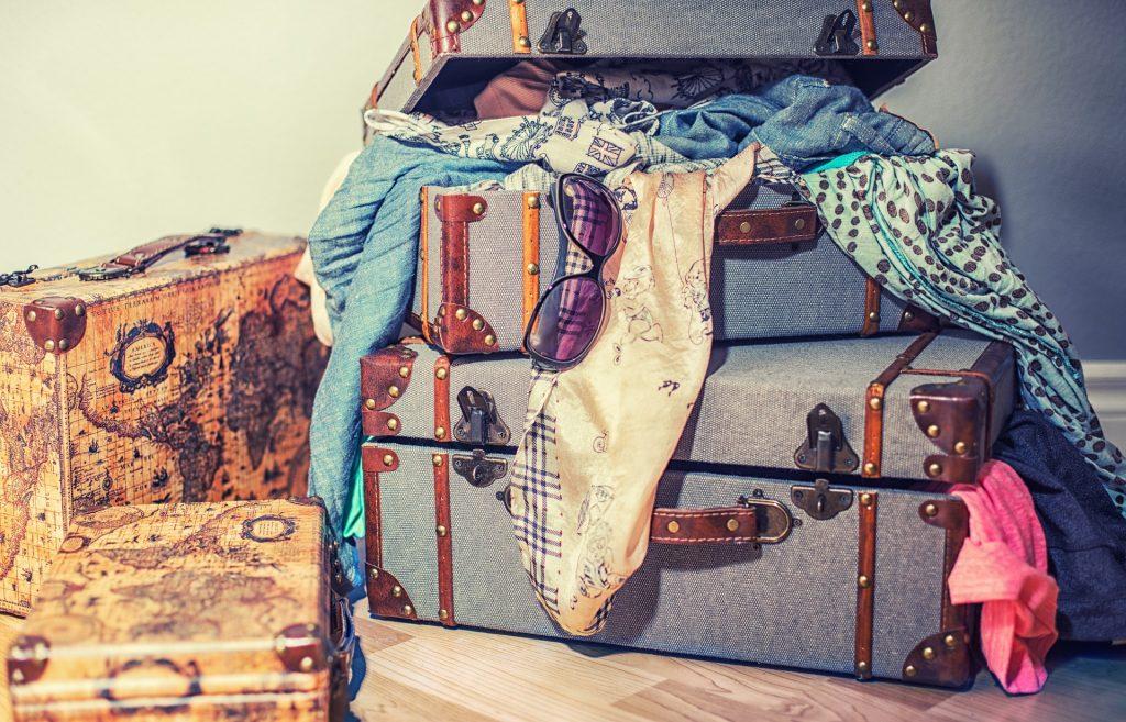 suitcases, sunglasses scarf